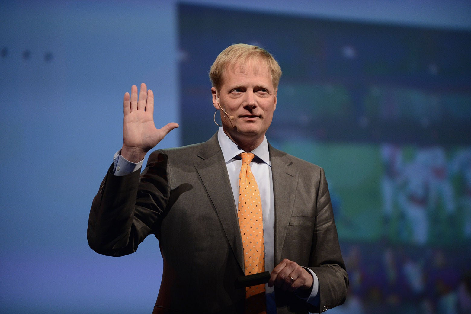 Brian Wansink raises a hand during the 2013 Discovery Vitality Summit in Johannesburg, South Africa.